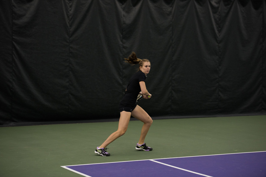 Erin Larner readies for a backhand. The junior led the Wildcats to a weekend sweep to open Big Ten play.