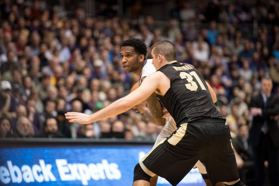 Sophomore forward Vic Law peers around Purdue's Dakota Mathias. Law scored just 4 points in Northwestern's loss to Purdue.