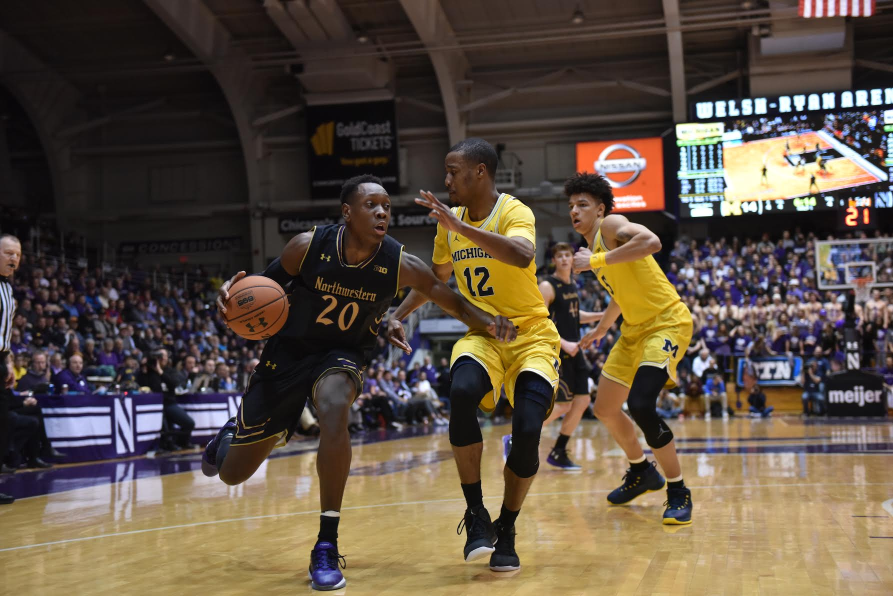 Scottie Lindsey dribbles past a defender. The Wildcats held off Michigan at home to earn the program's first-ever 21st regular season win.