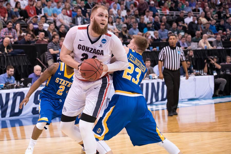 Przemek Karnowski fights past a defender. The Gonzaga big poses a challenge for Northwestern in the second round of the NCAA Tournament.
