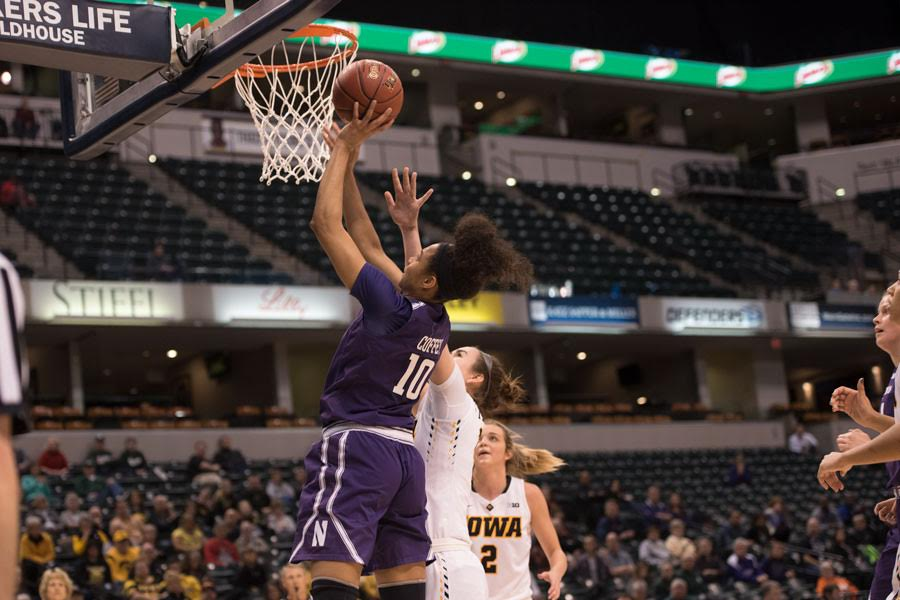 Nia Coffey attempts a layup. The senior put on an 34-point showstopper in Northwestern's Big Ten Tournament win over Iowa.
