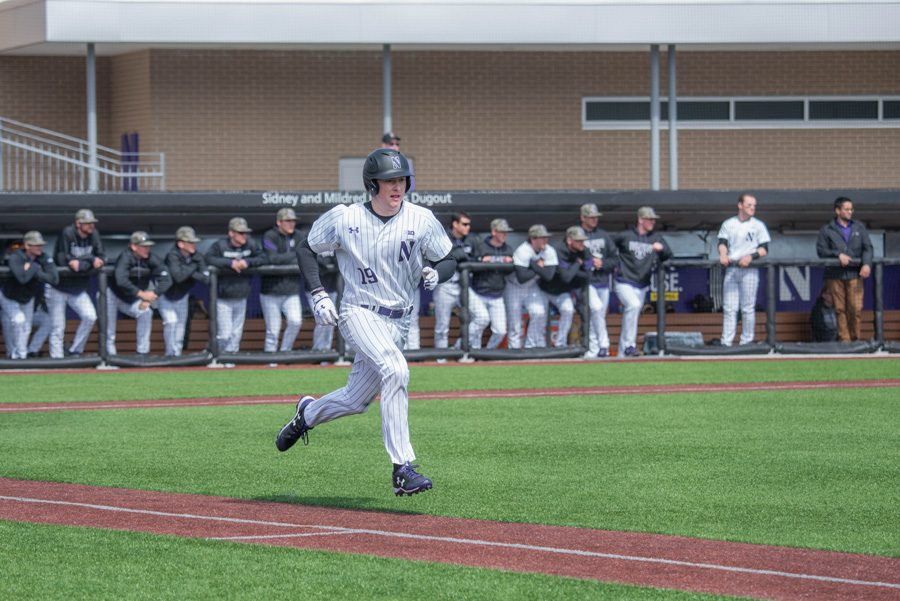 Matt Hopfner runs to first base. The senior outfielder and the Wildcats are seeking a victory at home Tuesday against Milwaukee.