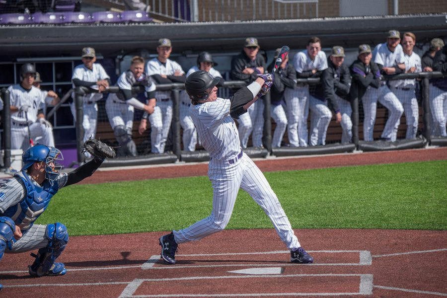 Jack Dunn swings through a pitch. The sophomore infielder and the Wildcats mustered just two hits in a shutout loss to UIC on Tuesday.