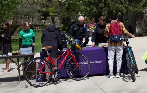 Bike 2 Campus week began Monday with a tune-up station on Sheridan Road. To promote bike safety, this year's Bike 2 Campus week includes free helmets and bike lights handed out by University Police.