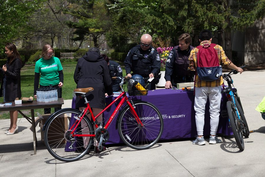 Bike+2+Campus+week+began+Monday+with+a+tune-up+station+on+Sheridan+Road.+To+promote+bike+safety%2C+this+year%E2%80%99s+Bike+2+Campus+week+includes+free+helmets+and+bike+lights+handed+out+by+University+Police.