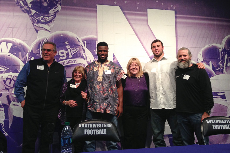 Attendees pose at a CatBackers event about the NFL draft Tuesday. CatBackers was founded in 1997 as an all-women's NU sports fan organization.