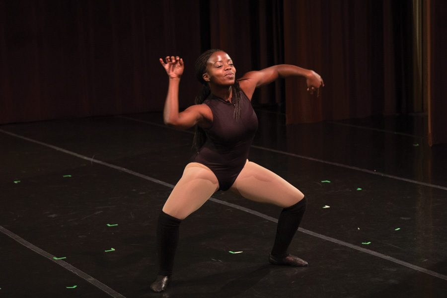 Communication+freshman+Desiree+Applewhite+performs+in+the+New+Movement+Project%E2%80%99s+Fall+Dance+Concert.+More+than+200+students+signed+a+petition+initiated+through+NMP+to+increase+the+number+and+variety+of+dance+classes+offered.