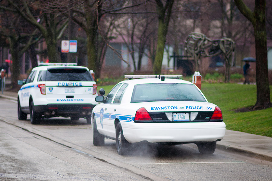 Two parked Evanston police cars. On Wednesday, a man filed a lawsuit after allegedly being hit by a vehicle that was being pursued by Evanston police officers.