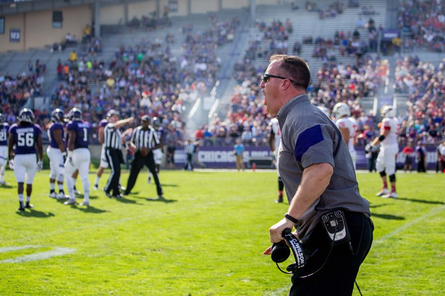 Football coach Pat Fitzgerald yells during a game. Fitzgerald and men's basketball coach Chris Collins received contract extensions on Monday, according to reports.