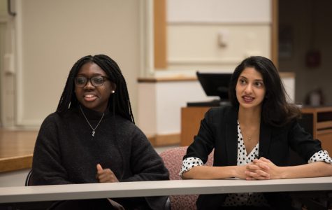 ASG candidates for president and executive vice president Nehaarika Mulukutla and Rosalie Gambrah speak during a Daily-moderated forum Wednesday in Fisk Hall. The pair hopes to increase awareness of ASG's purpose on campus.