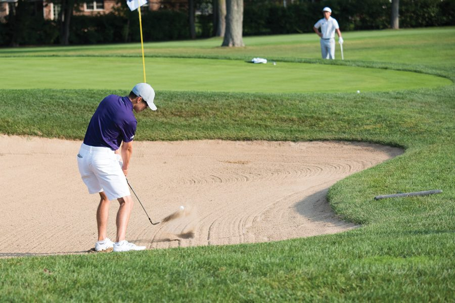 Everton+Hawkins+chips+out+of+a+sand+trap.+The+freshman+and+the+Wildcats+are+seeking+consistency+at+the+Boilermaker+Invitational.