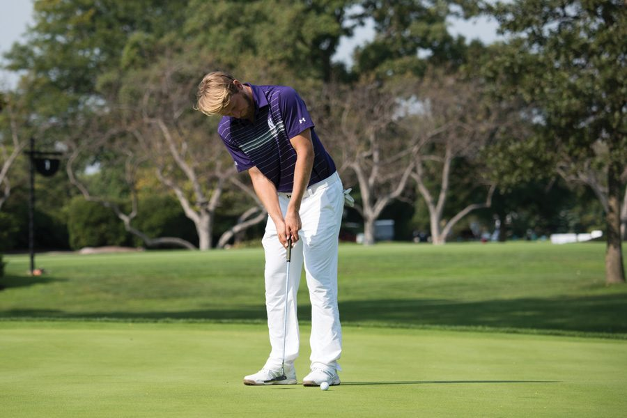 Andrew Whalen watches his putt. The senior helped lead the Wildcats to a third place finish at the Boilermaker Invitational.