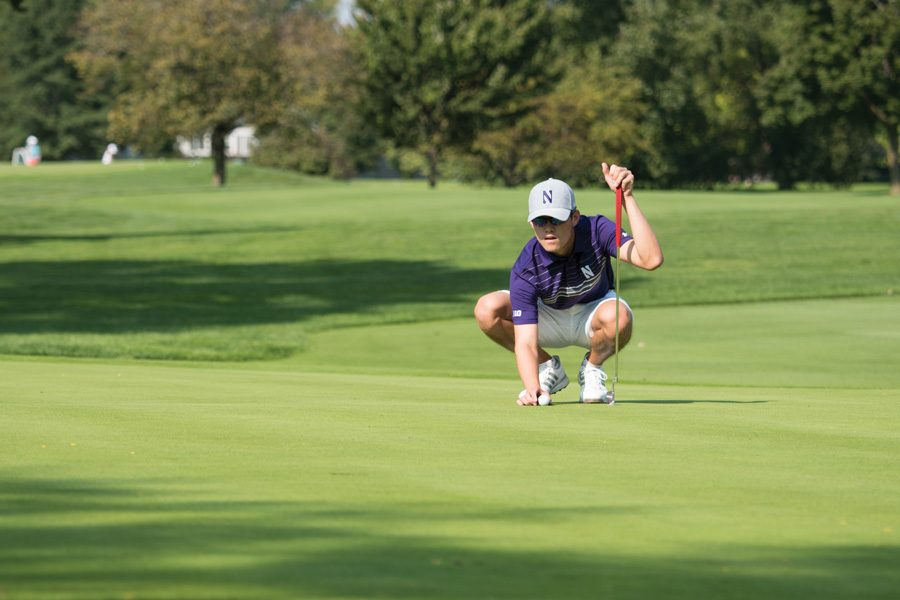 Everton Hawkins lines up a putt. The freshman and the Wildcats look to stay hot at the Redhawk Invitational this week.