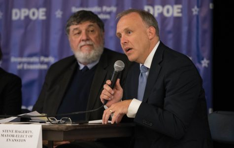 Mayor-elect Steve Hagerty speaks at a Sunday immigration panel hosted by the Democratic Party of Evanston. The panel discussed President Donald Trump's immigration policy and his recent executive orders.