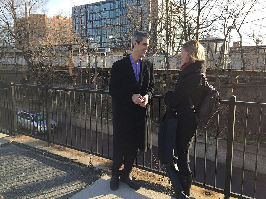 "State Sen. Daniel Biss (D-Evanston) speaks with a supporter at a ""meet and greet"" last month. Biss and State Sen. Jacqueline Collins (D-Chicago) plan to introduce legislation prohibiting car insurers from using ZIP codes to determine premium rates."