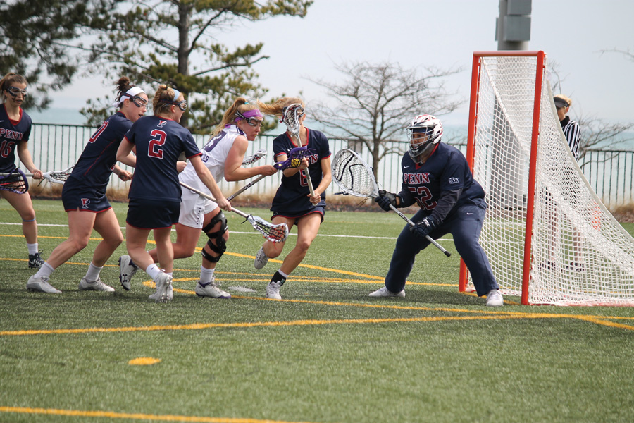 Shelby Fredericks is swarmed by defenders. The junior attacker and the Wildcats struggled against Penn's zone defense in Sunday's loss.