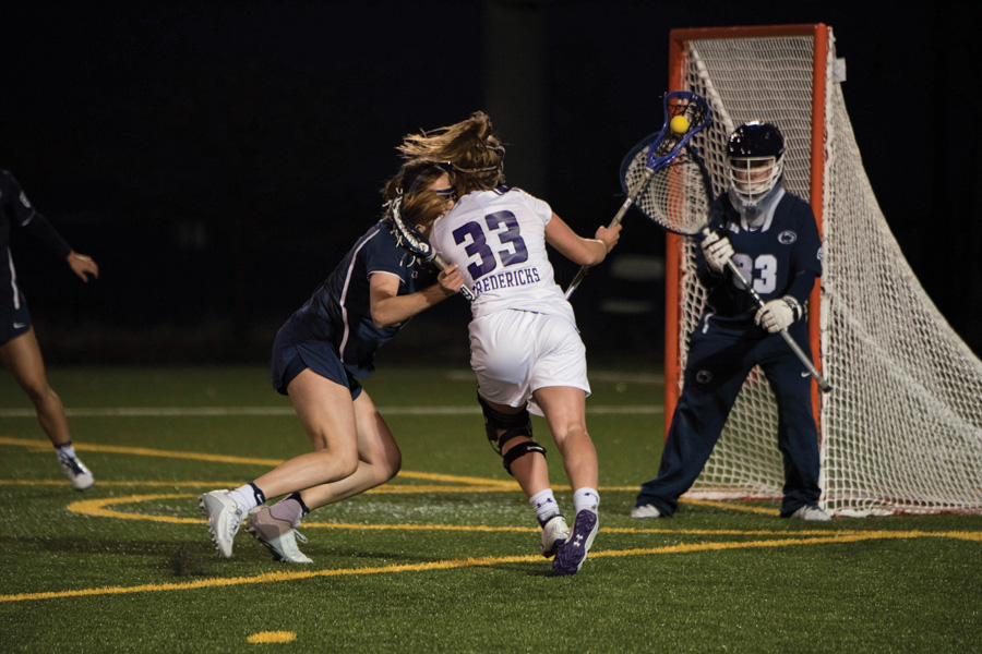 Shelby Fredericks fights against a defender. The junior attacker set a program record with 17 draw controls, but the Wildcats lost a thriller against Penn State.