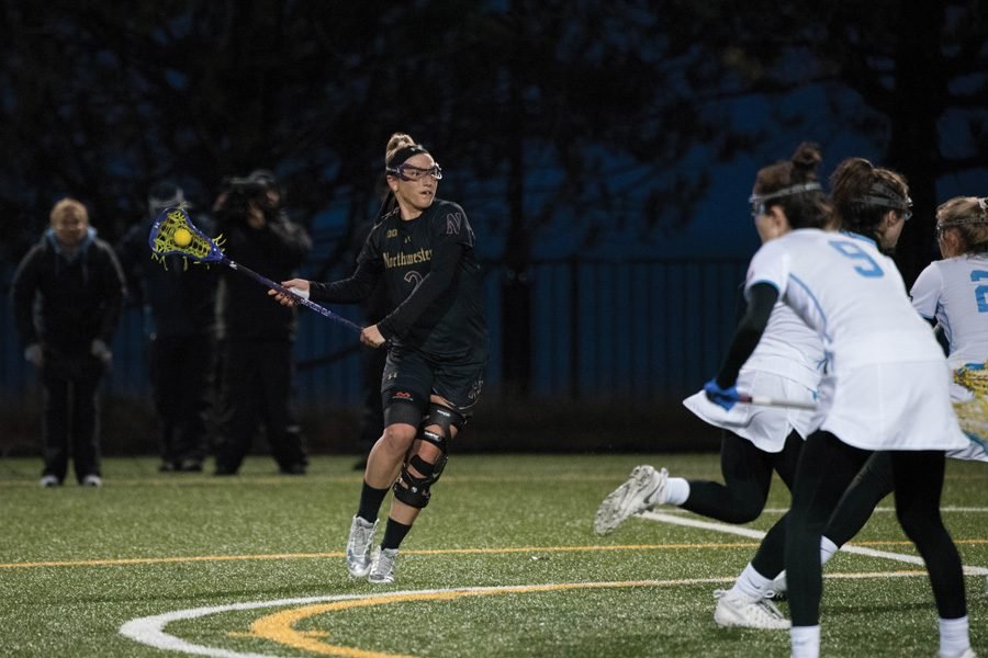 Christina+Esposito+looks+for+an+opening+to+take+a+shot.+The+senior+attacker+will+try+to+build+upon+her+team-leading+34+goals+in+a+crucial+contest+against+Rutgers+on+Saturday.
