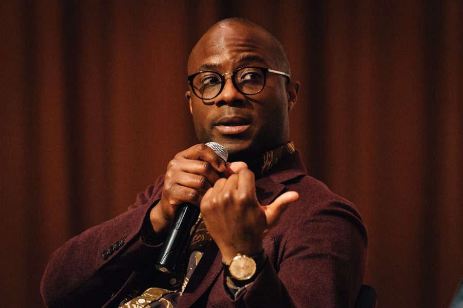 """Moonlight"" director Barry Jenkins speaks at Ryan Auditorium in the Technological Institute on Saturday. The Academy Award-winning director discussed the inspiration behind the film as well as issues of representation."