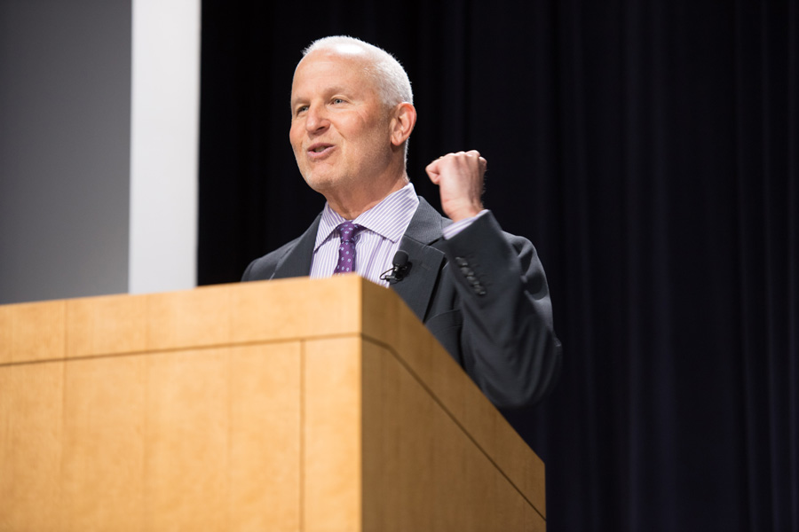"University President Morton Schapiro speaks during a ""Conversations with the President"" event held in the McCormick Foundation Center Forum on Tuesday. President Schapiro, along with other University administrators, discussed key issues affecting the University with students, faculty and staff."