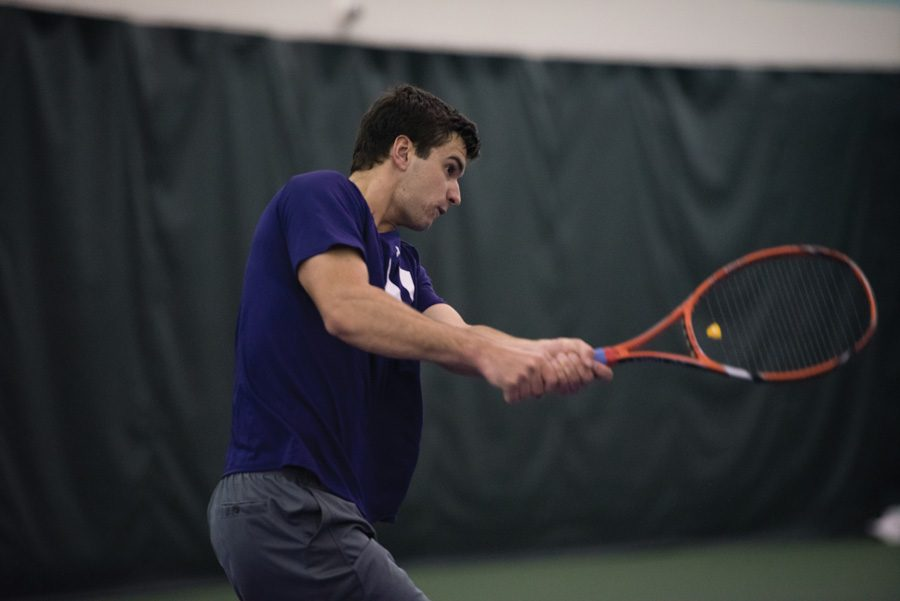 Konrad Zieba follows his shot. The senior fell in the deciding match against Michigan on Sunday.
