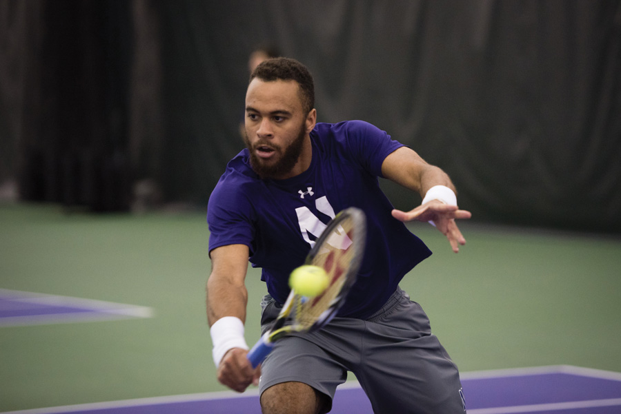 Sam Shropshire lunges for a volley. The senior helped the Wildcats to a pair of Big Ten wins this weekend.