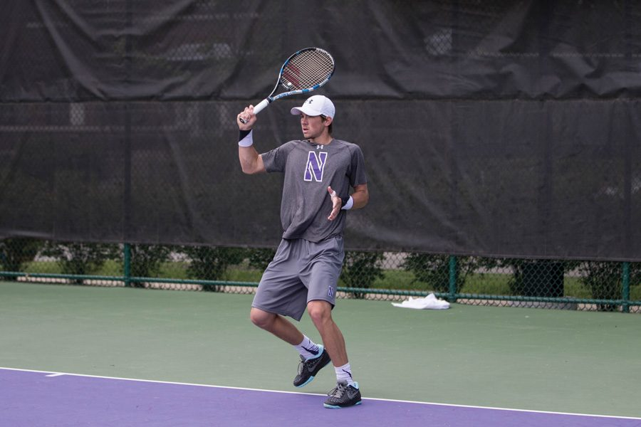 Strong Kirchheimer completes a swing. The senior won his 100th career singles match in the Wildcats' weekend split.