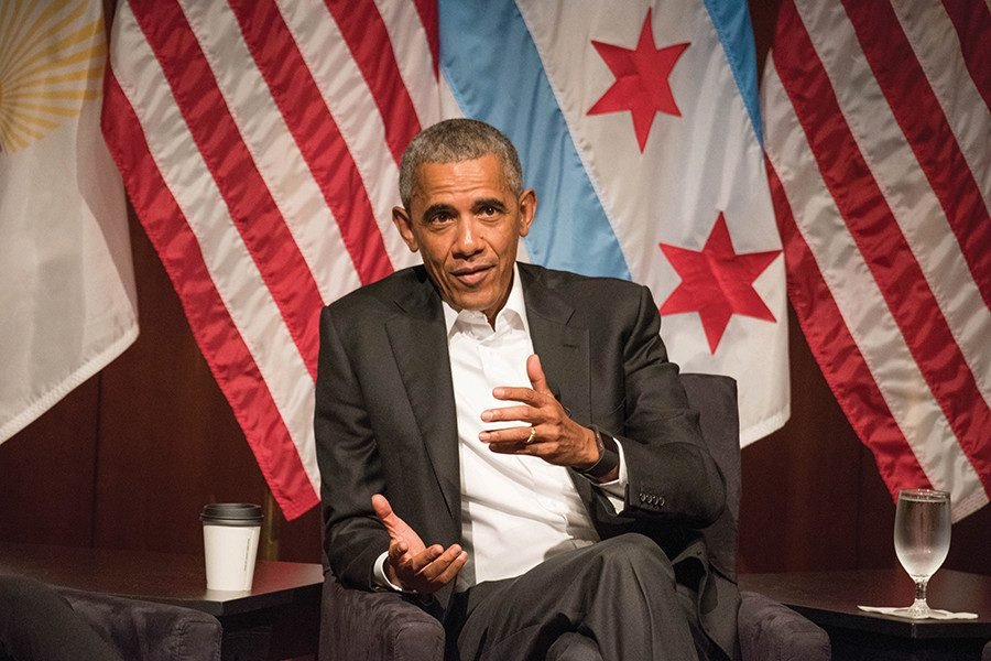 Former President Barack Obama speaks on a panel at the University of Chicago on Monday. The event marked an end to Obama's self-imposed silence following Inauguration Day earlier this year.