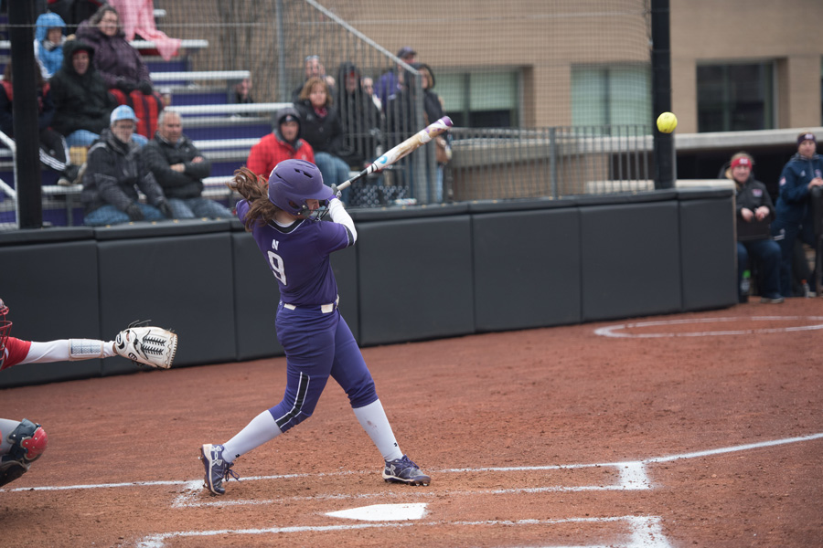 Lily Novak swings at a pitch. The sophomore infielder and the Wildcats were blown out by Notre Dame on Tuesday.