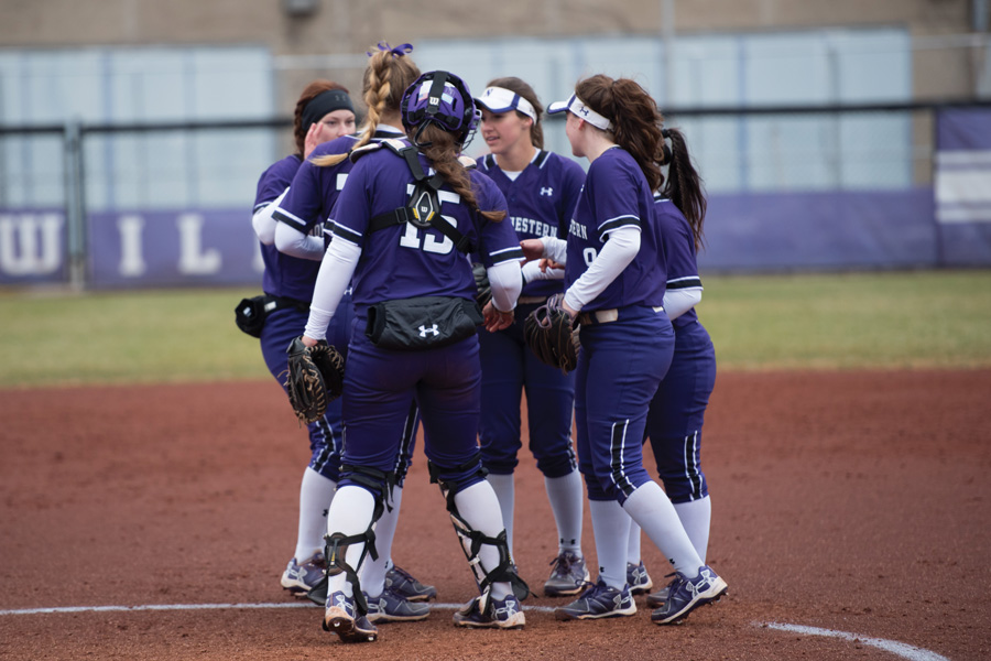 Several Wildcats converse in the circle. Northwestern was shut down in a series sweep at Minnesota this weekend.