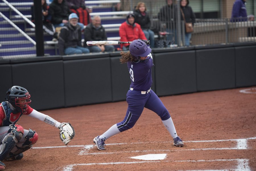 Lily Novak swings through the ball. The sophomore infielder and the Wildcats were shut out three times in weekend losses.