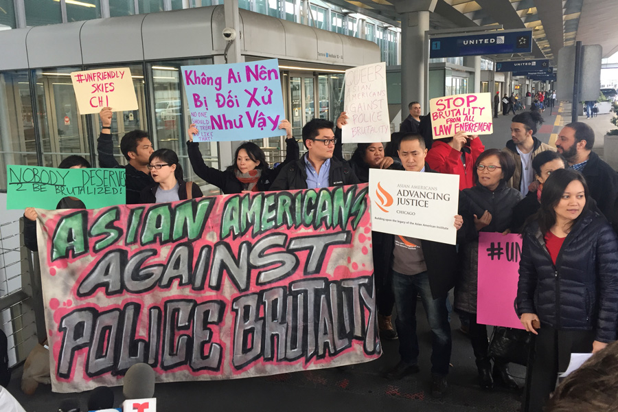 Protesters at a rally at O'Hare International Airport on Tuesday. Various Chicago organizations gathered to demand accountability from United Airlines after a passenger was forcibly removed from a flight last weekend.