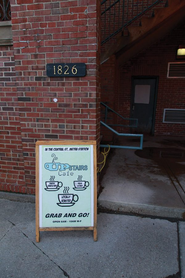 A sign outside Upstairs Cafe at Central Street Metra. In early May, the owners of Upstairs Cafe will have to vacate the property after failing to reach an agreement with Union Pacific railroad.