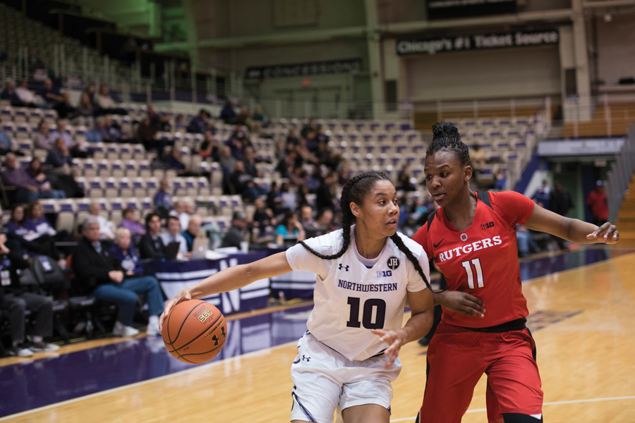 Nia Coffey races past a defender. The former NU player was selected fifth overall in the WNBA Draft on Thursday.