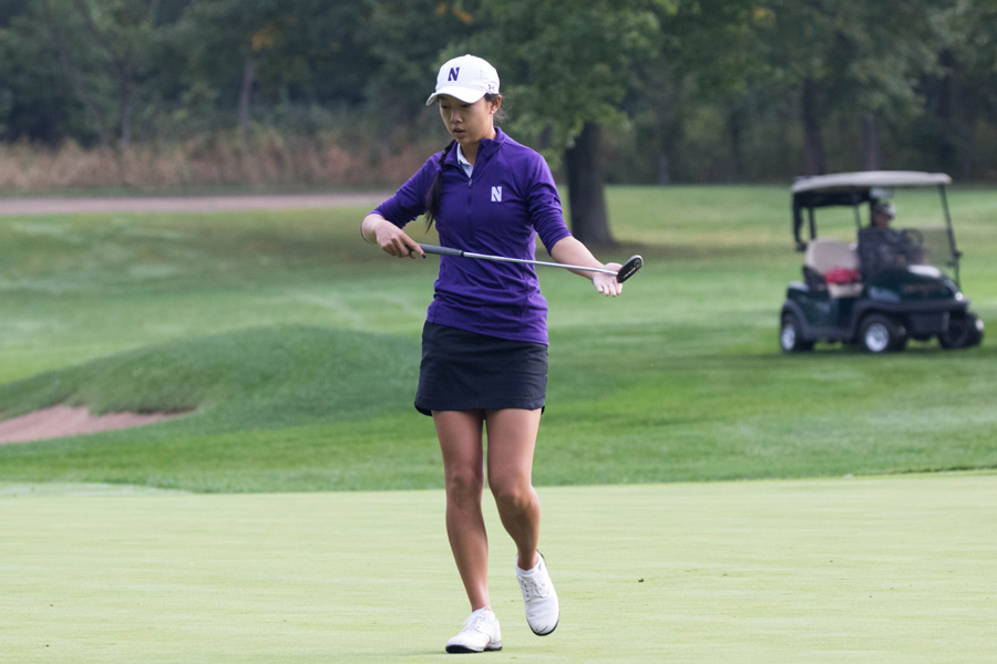 Janet Mao carries her putter. The sophomore and the Wildcats blew an eight-stroke lead in the final round of the Big Ten Tournament.