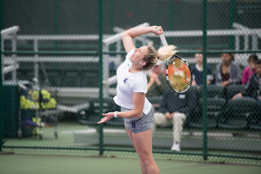 Alex Chatt fires a serve. The junior and the Wildcats split their final regular season matches.