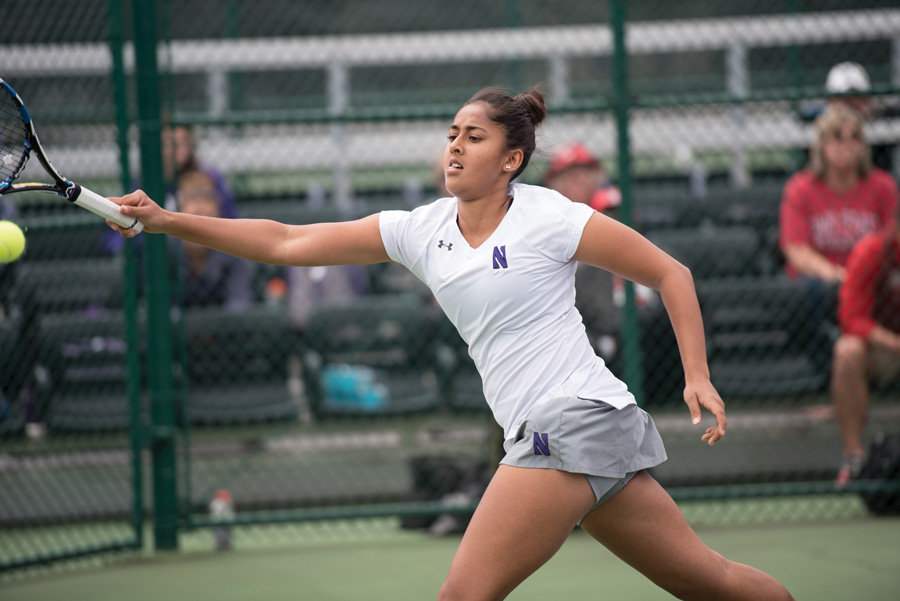 Rheeya Doshi chases after a groundstroke. The sophomore and the Wildcats saw their streak of Big Ten perfection end this weekend.