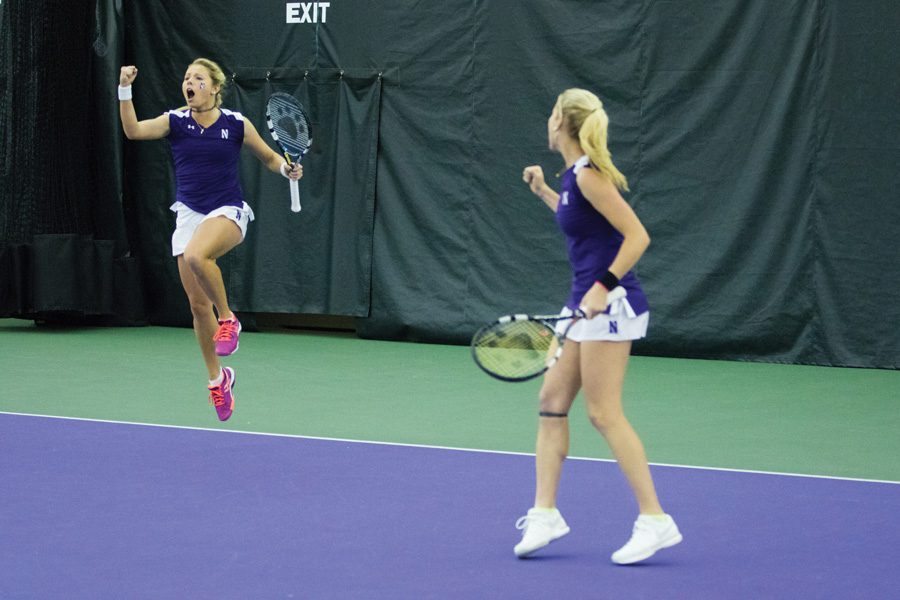 Alex+Chatt+%28left%29+celebrates+a+point+with+her+doubles+partner%2C+Maddie+Lipp.+The+juniors+and+the+Wildcats+are+seeking+to+extend+their+unbeaten+start+to+Big+Ten+play.