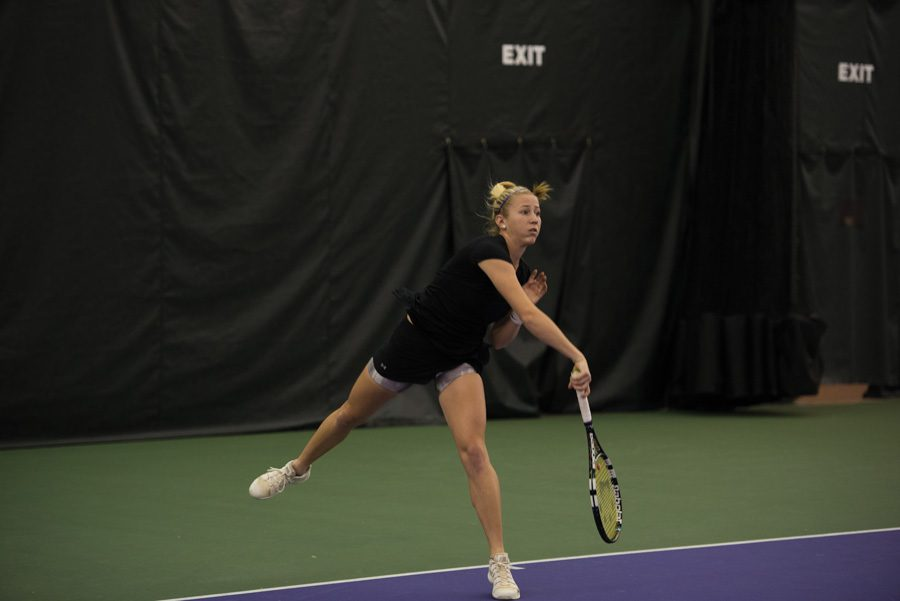 Maddie+Lipp+finishes+her+serve.+The+junior+and+the+Wildcats+rolled+to+two+more+Big+Ten+wins+this+weekend.