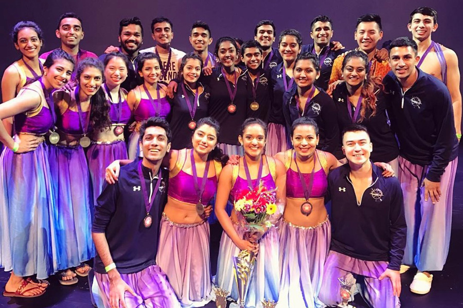 Anubhav+poses+after+claiming+the+national+championship+title.+The+team+placed+first+for+the+third+time+for+their+performance+based+on+%E2%80%9CLife+of+Pi.%E2%80%9D