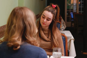 "Communication freshman Alison Martin, who plays the character Carrie Helsing, and Cheryl Golemo, who plays character Nic Helsing, perform on set for ""Helsing"" at Chef's Station in Evanston. The film, which is Applause for a Cause's newest release, will premiere on campus on Friday."