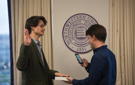 Lars Benson is sworn in as chief of staff at Wednesday's Associated Student Government Senate. The Weinberg junior previously served as a residential senator.