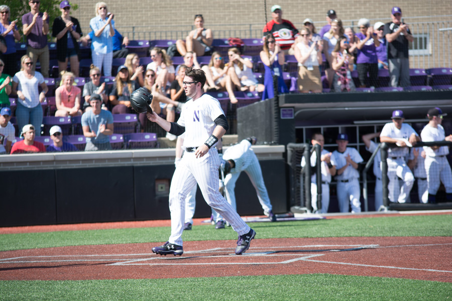 Jack Claeys crosses home plate. The junior catcher and the Wildcats begin play in their first Big Ten Tournament in seven years on Wednesday.