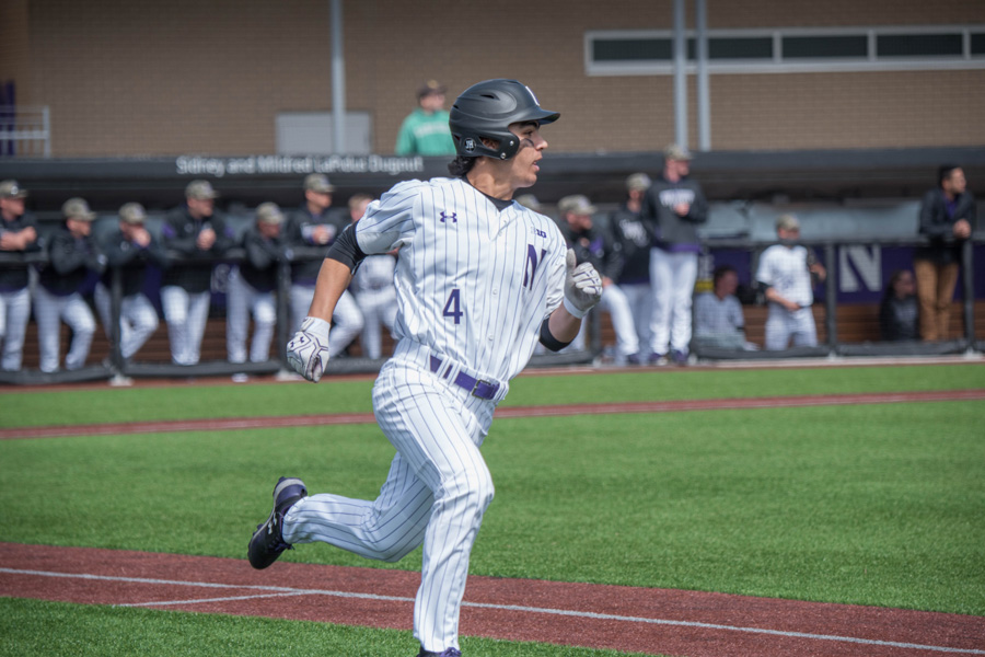 Alex+Erro+watches+the+ball+as+he+rounds+first+base.+The+freshman+infielder+played+a+major+role+in+Northwestern%E2%80%99s+series+win+over+Purdue+and+could+be+critical+again+this+weekend+at+Maryland.