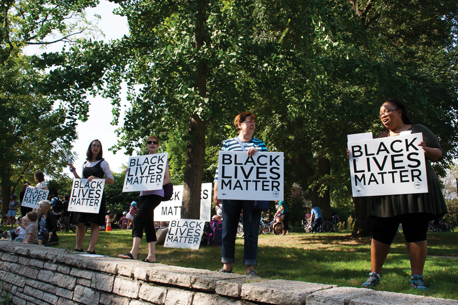 People stand holding Black Lives Matter signs. After two years of selling over 1,500 signs in Evanston, community organization Making Evanston Equitable Together is bringing its Black Lives Matter sign campaign to a close.
