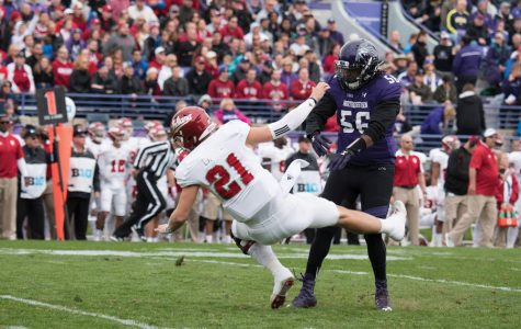 Xavier Washington makes a tackle. The Northwestern football player was arrested Sunday in connection with drug possession charges.