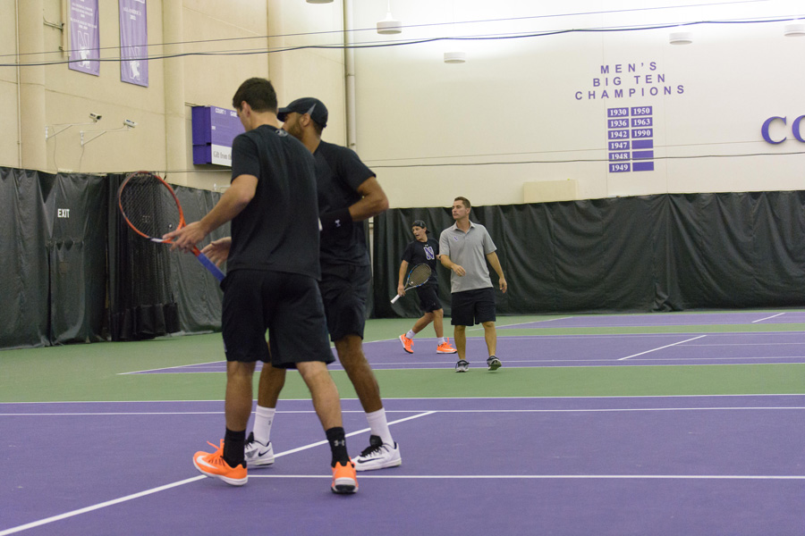 Sam Shropshire and Konrad Zieba chat between points. The seniors have helped lead the Wildcats to some of their finest ever seasons in their time in Evanston.