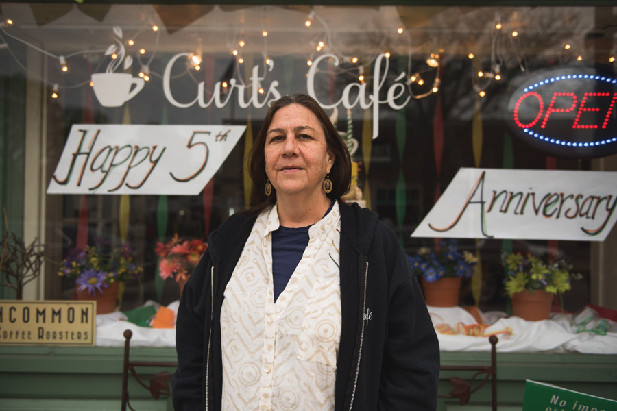 Founder and executive director of Curt's Café Susan Trieschmann stands outside her Central Street location. Trieschmann was one of five Oakton Community College graduates who received the Distinguished Alumni award on Wednesday for their professional and community achievements.