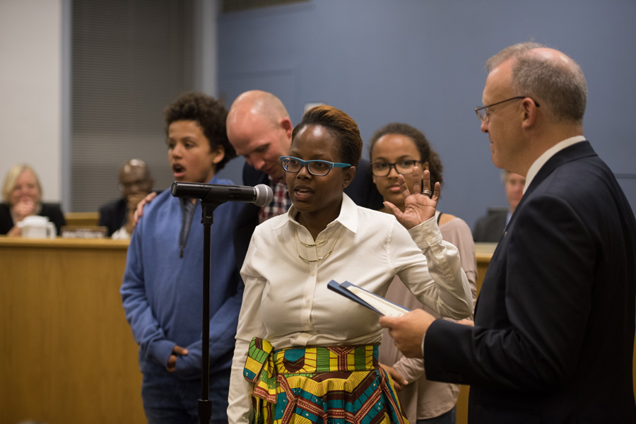 Cicely Fleming (9th) is sworn into office at a meeting on Monday. Fleming said she believes there is historic diversity in city government this year.