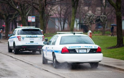 "Two parked Evanston police cars. The Evanston Police Department kicked off a ""Click It or Ticket"" campaign Monday to encourage the use of seatbelts."